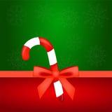 Kerstmissuikergoed met rode boog Stock Afbeelding