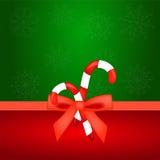 Kerstmissuikergoed met rode boog Stock Foto