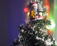 Kerstmisthema Santa Claus en onscherpe lichten Stock Foto