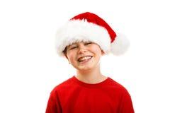 Kerstmistijd - jongen met Santa Claus Hat Stock Foto's