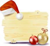 Kerstmisuithangbord met Kerstmishoed Stock Fotografie