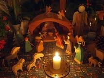 Kerstmisvoederbak met kaars Stock Afbeelding