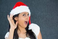 Kerstmisvrouw het afluisteren Royalty-vrije Stock Afbeeldingen