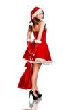 Kerstmisvrouw in Santa Claus-hoed stock foto