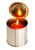 Kerze auf einer Blechdose Stockfoto