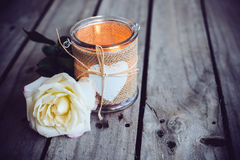 Kerze in einem dekorativen Glas Stockfotografie