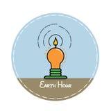 Kerze in Form einer Lampe auf einem blauen Hintergrund Lizenzfreie Stockbilder