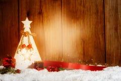Kerze/Laterne mit Lichtstrahl in einer Sternform vor flehen an Stockbilder