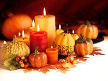 Kerze und Kürbise Lizenzfreies Stockbild