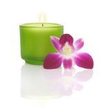 Kerze und Orchidee Stockfotos