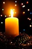 Kerze und Spielzeug Stockfoto