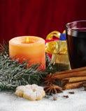 Kerze und verrührter Wein Stockbild