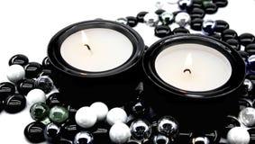Kerzen in den Kerzenhaltern Stockfotografie