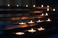 Kerzen in der Reihe Stockbild
