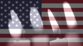 Kerzen und amerikanische Flagge stock video footage