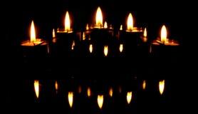 Kerzen und Reflexionen Stockbilder