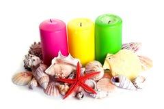 Kerzen und Shells Stockbild