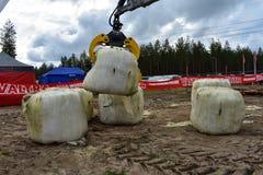 Kesla crane at work lifting bales royalty free stock photography
