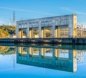 Keswick Dam reflection. Sacramento River reflecting Keswick Dam in Redding, CA. Walk along the Fisherman`s trail gives a fresh perspective on the dam.  The power Stock Photo