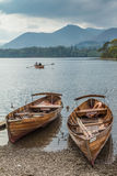 KESWICK, UK - SEP 9, 2014: People row a boat on Derwent Water in. The English Lake District Royalty Free Stock Photography