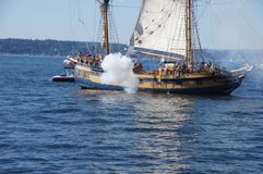 The ketch, Hawaiian Chieftain, fires her cannon Royalty Free Stock Image