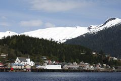 Ketchikan Skyline. Ketchikan city skyline with snow-covered mountains in a background (Alaska royalty free stock images