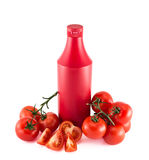 Ketchup copyspace bottle surrounded with tomatoes Royalty Free Stock Photos