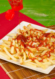 Ketchup on french fries Royalty Free Stock Photo