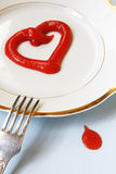 Ketchup heart with a drop Stock Image