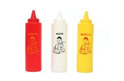 Ketchup, Mayo e mostarda Fotografia de Stock Royalty Free