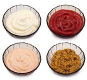Ketchup, Mayo, mostarda e molho Imagem de Stock