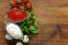Ketchup and mayonnaise in glass saucers Stock Photography