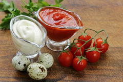 Ketchup and mayonnaise in glass saucers Stock Images