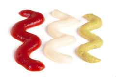 Ketchup mayonnaise and mustard isolated on white background Royalty Free Stock Photos