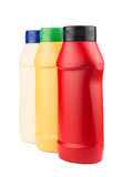 Ketchup, mayonnaise and mustard no label plastic bottles. Side view of ketchup, mayonnaise and mustard blank plastic bottles on white background stock images