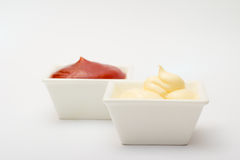 Ketchup and mayonnaise on white background Royalty Free Stock Images