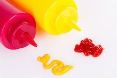 Ketchup and Mustard. Bottles with swapped spills Royalty Free Stock Photos