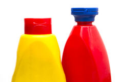 Ketchup and mustard bottle. A ketchup and mustard bottle isolated on white Royalty Free Stock Photos