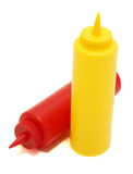 Ketchup and mustard bottles. Pair of restaurant style mustard and ketchup bottles isolated on the white background stock photos