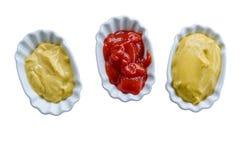 Ketchup and mustard in bowls Stock Image