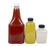 Ketchup, Mustard and Horseradish in Bottles Royalty Free Stock Photo