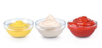 Ketchup, mustard. And mayonnaise in glass bowls stock image