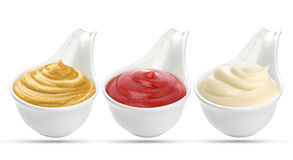 Ketchup, mustard, and mayonnaise sauces in bowl isolated on white background. Ketchup, mustard, and mayonnaise in bowl isolated on white background royalty free stock images