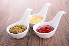 Ketchup, mustard and pesto sauce Stock Images