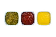 Ketchup mustard pickles Stock Photos
