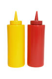 Ketchup and mustard squeeze bottles. Red and yellow ketchup and mustard squeeze bottles royalty free stock images