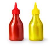 Ketchup- och senapbottl Arkivbild
