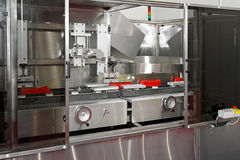 Ketchup packaging line. Packaging machine for packing ketchup in plastic bottles Stock Image