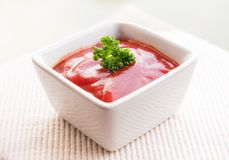 Ketchup and parsly. The white sqare bowl ketchup and parsley Royalty Free Stock Images