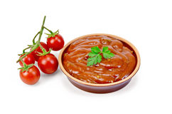 Ketchup in pottery with tomatoes Stock Image